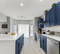 Navy blue modern kitchen cabinets shaker doors waterfall quartz island